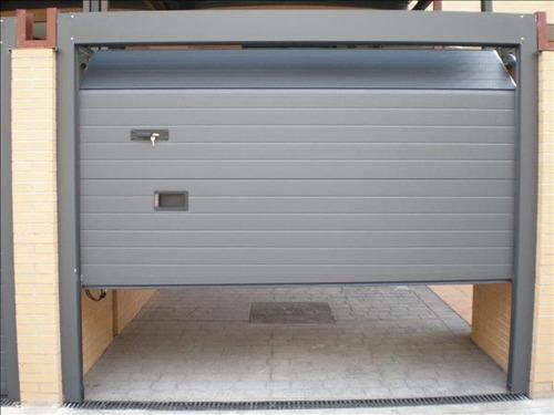Puertas automaticas portones electricos control de - Puertas de garaje precios ...